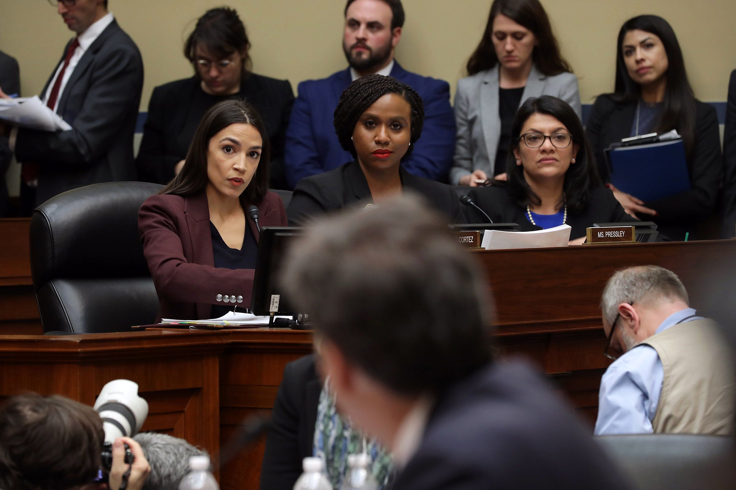Reps. Alexandria Ocasio-Cortez (D-NY), Ayanna Pressley (D-MA) and Rashida Tlaib (D-MI) listen as Michael Cohen, former attorney and fixer for President Trump, testifies before the House Oversight Committee in Washington, D.C., on Feb. 27.