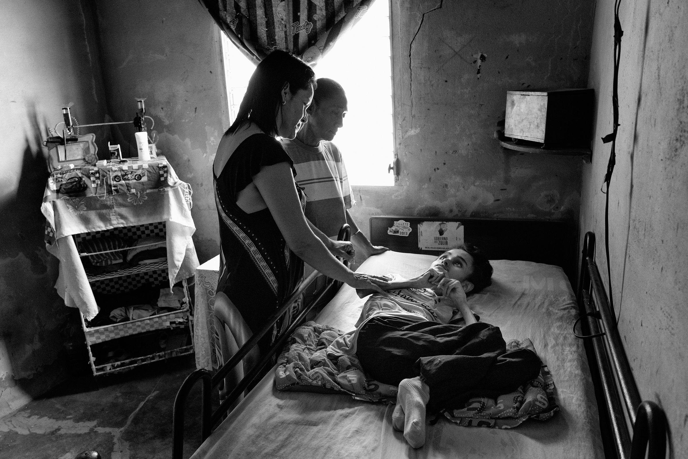 Miguel Blanco, 28, has a neurological condition and suffers from extreme malnutrition. Blanco was photographed in April in El Barrio Alto de Milagros Norte in Maracaibo, Venezuela.