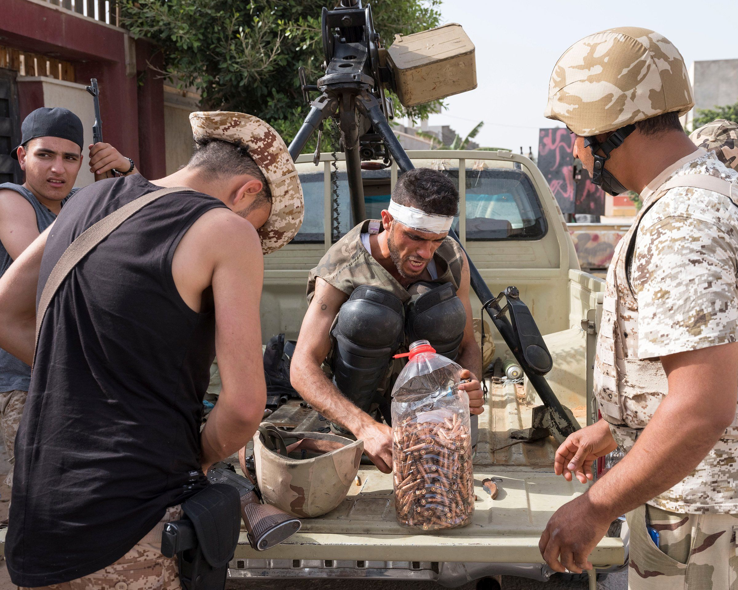 Forces allied with the U.N.-backed government reload ammo on the frontline outside Tripoli in April.