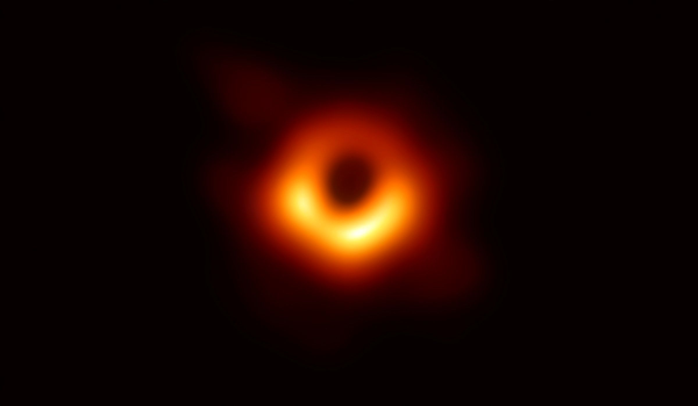 An image released on April 10 reveals the black hole at the center of Messier 87, a massive galaxy in the nearby Virgo galaxy cluster. This black hole resides 55 million light-years from Earth and has a mass 6.5-billion times that of the Sun.