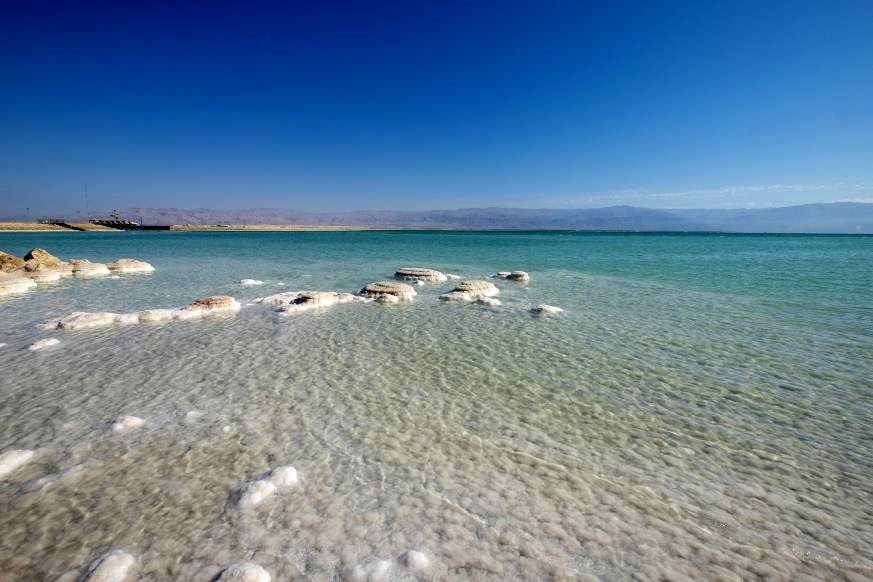 """Slide 9 of 16: Although it's called a """"sea,"""" this isn't an ocean—it's a saline lake surrounded by desert. With its extremely high salt content, five to nine times that of the ocean, the clear water of the Dead Sea is said to have medicinal properties. But because of its salinity, no fish can survive in it, hence its name. The Dead Sea has only one main source, the River Jordan, and the only way water gets out is through evaporation, during which its minerals are left behind. But although the lake is rich in these minerals, the water still retains its clear properties because there's nothing else in it. The Dead Sea also ranks in our list of 80 gorgeous travel photos from around the world."""