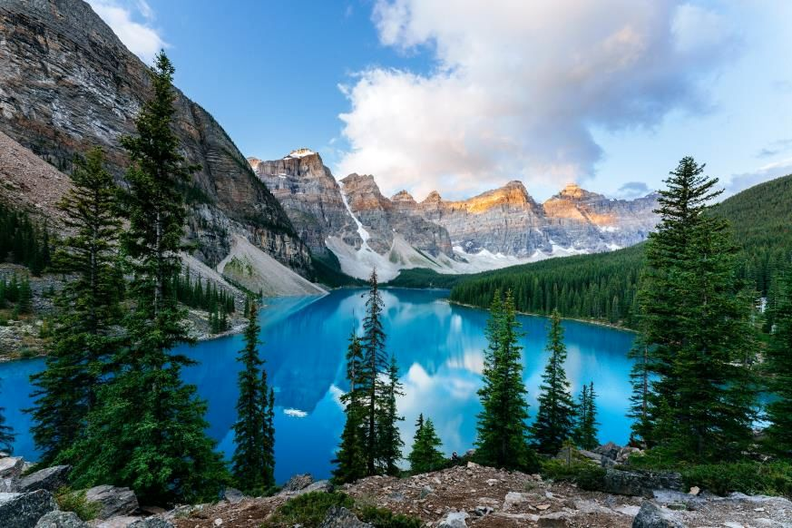 """Slide 2 of 16: Canada is renowned for its lovely lakes, as the country's alpine locales lend themselves to the creation of crystal-clear mountain waters. Lake Louise in Banff National Park in the province of Alberta is perhaps the most popular, and it's """"clearly"""" (pun intended) gorgeous. But our pick is the nearby Moraine Lake, a glacial-fed body of water with a transparent blue hue nestled in the Valley of the Ten Peaks. The color changes depending on where the lake is viewed from, the time of day, and even the time of year—summer provides the brightest hue. The lake is so stunning it was even featured on the Canadian $20 bill in the 1970s. These are more of the most popular destinations in Canada."""