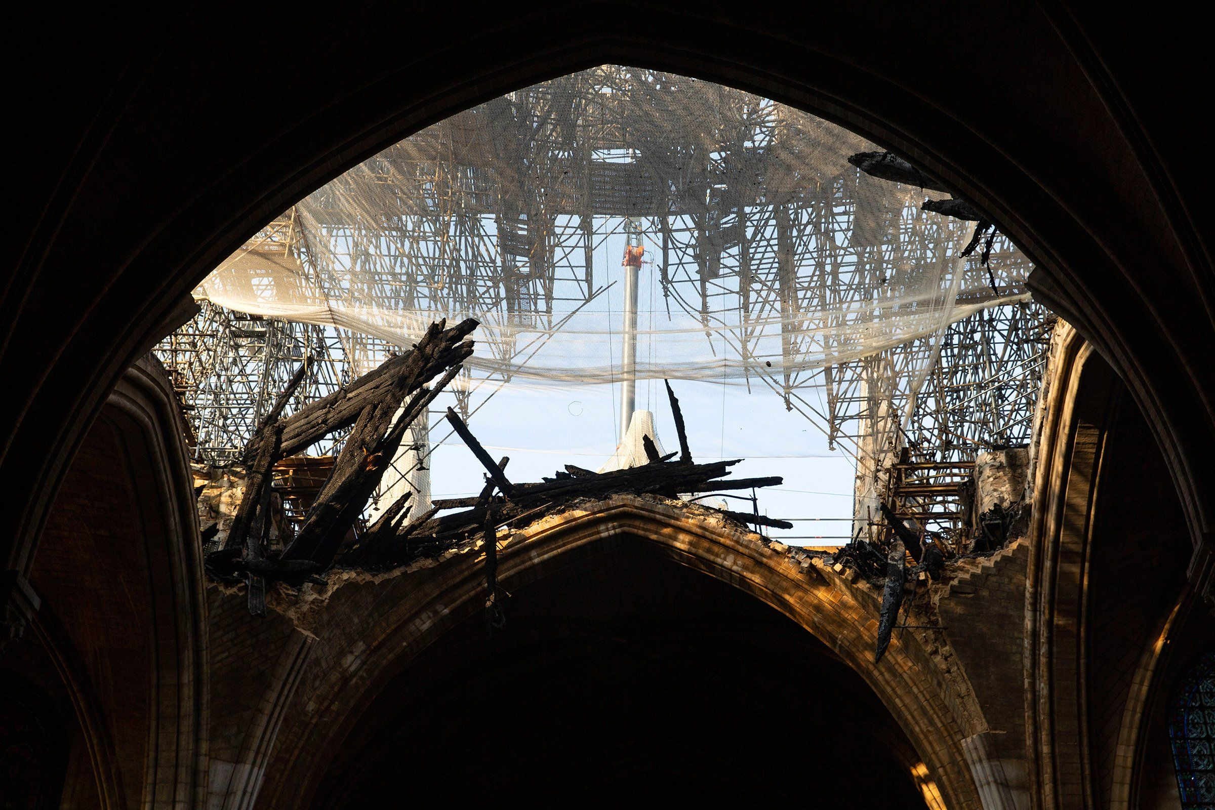 Significant damage to Notre Dame's roof, seen on June 26, left its interior open to the elements months after the April blaze.
