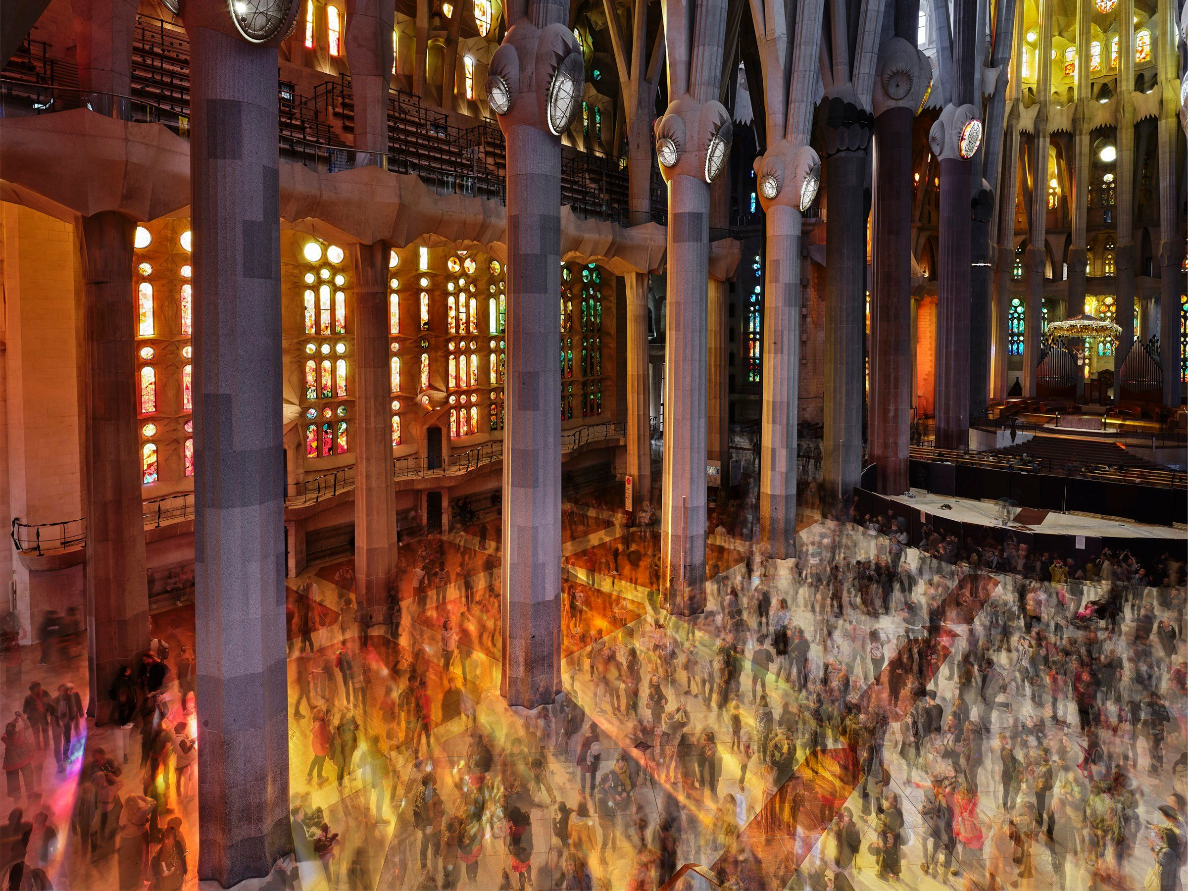 Visitors inside the nave of Barcelona's Sagrada Familia on March 18. The entry fees of roughly 4 million visitors each year help provide the money needed to finish construction. A team is working to complete Sagrada Familia by 2026.