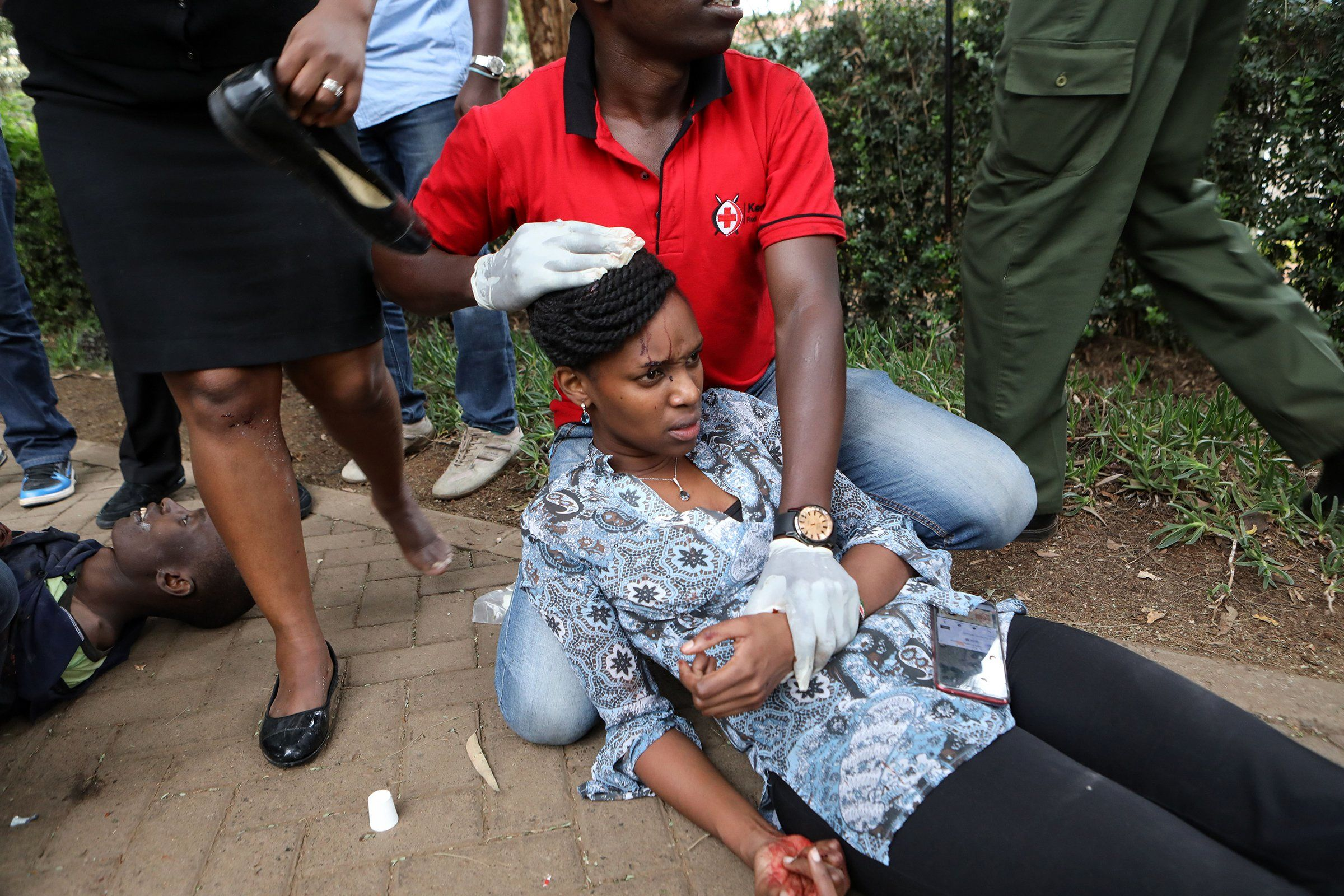 A woman receives medical attention after an apparent terrorist attack on an upscale hotel in Nairobi on Jan. 15. More than a dozen people were killed.