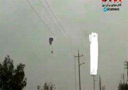 گرفتاری چترباز (پاراگلایدر) در دام کابلهای برق/فیلم