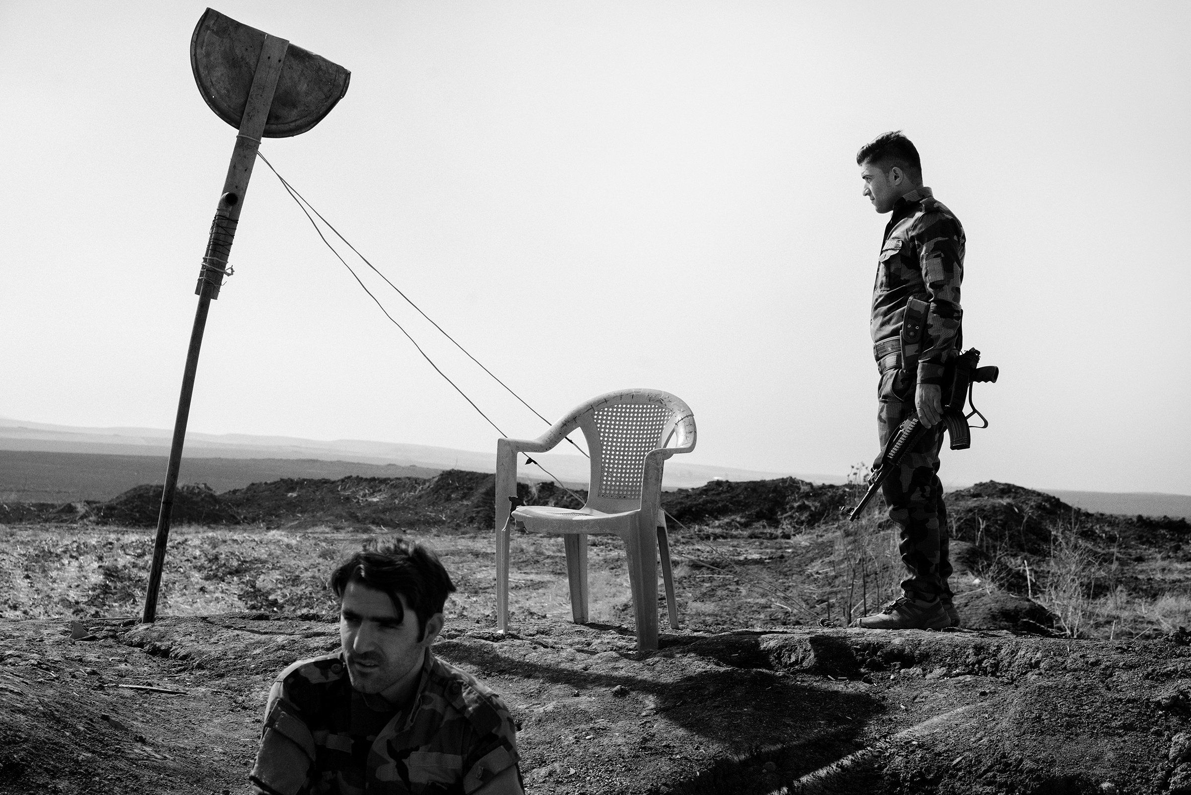 Kurdish fighters guard the new border between Kurdistan Regional Government-controlled territory and areas under the control of the Iraqi army near the town of Bashiqa, liberated from ISIS in 2016 by Iraqi and Kurdish forces.